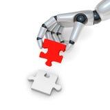 Puzzle rouge dans le robohand Photographie stock libre de droits