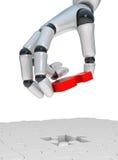 Puzzle rouge dans le robohand Image stock