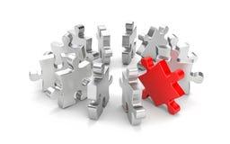 Puzzle rouge parmi les autres puzzles de gris Image stock