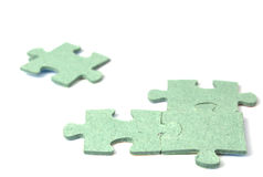 Puzzle from a rough cardboard. On a white background it is isolated Royalty Free Stock Photo