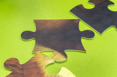 Puzzle scattered on green table. Puzzle scattered on a green table Royalty Free Stock Photos