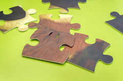 Puzzle scattered on green table. Puzzle scattered on a green table Stock Photography