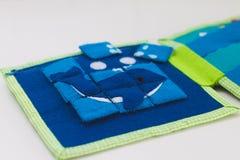 Puzzle se développant de jouet de tissu Photographie stock