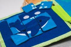 Puzzle se développant de jouet de tissu Photographie stock libre de droits