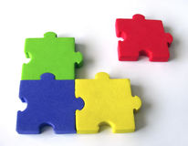 Puzzle series. Objective metaphor of group, teamwork, leaders and outsiders Royalty Free Stock Image