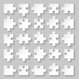 Puzzle set. Set of blank white puzzle pieces on grey background Royalty Free Stock Images
