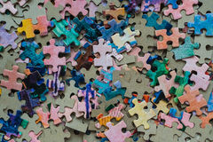 Puzzle set colored. On a table Royalty Free Stock Photos