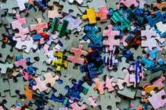 Puzzle set. Colored on a table Royalty Free Stock Photos
