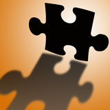 Puzzle shadow. Shadow of a puzzle piece (concept for finding the solution Stock Photography