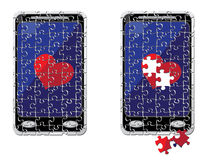 Puzzle smart phone and heart Stock Photos