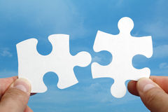 Puzzle solution stock images