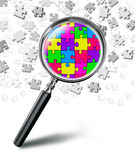 Puzzle solution concept with magnifying glass on white backgroun Stock Image