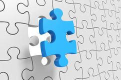 Puzzle solution, final jigsaw piece being inserted for completion Royalty Free Stock Image