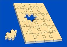 Puzzle almost solved. Isolated over a blue background Stock Photos
