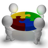 Puzzle Solved And 3d Characters Showing Union And Cooperation Royalty Free Stock Images