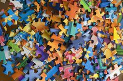 Puzzle. Some puzzle pieces on the table royalty free stock images