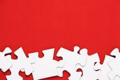 Puzzle su rosso Fotografie Stock