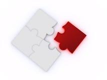 Puzzle su una priorità bassa bianca Immagini Stock
