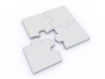 Puzzle su una priorità bassa bianca Immagine Stock