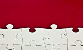 Puzzle sur le fond rouge Photo libre de droits