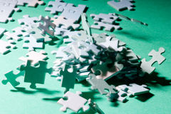 Puzzle tsunami. Miniature people on a jigsaw puzzle in windstorm Royalty Free Stock Image