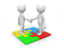 Puzzle. Two 3d people standing a puzzle, hands shaking Stock Photo