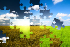 Puzzle from two landscapes Stock Photography