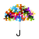 Puzzle umbrella. Use puzzle to form an umbrella Royalty Free Stock Photography
