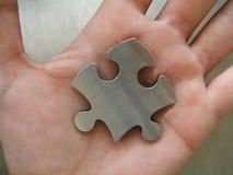 Puzzle in una mano Fotografia Stock Libera da Diritti