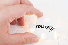 Puzzle which written strategy Stock Image