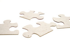 Puzzle on white. Shot of a puzzle on white background stock image