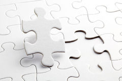 Puzzle white pieces. One piece is taken out royalty free stock image