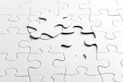 Puzzle white pieces Stock Images