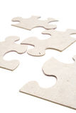 Puzzle on white vertical. Shot of a puzzle on white background royalty free stock photo