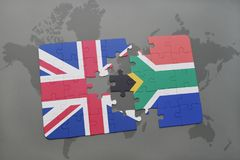 Puzzle With The National Flag Of Great Britain And South Africa On A World Map Background. Stock Photography
