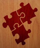 Puzzle - Wood Version. There are three plugs of a wood puzzle Stock Photo