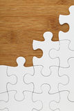 Puzzle on wooden board Royalty Free Stock Photos