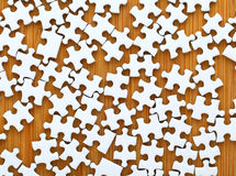 Puzzle on wooden board Stock Photography