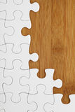 Puzzle on wooden board Stock Photo