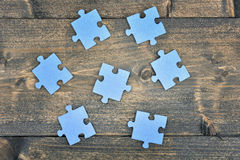 Puzzle on wooden table Royalty Free Stock Photography