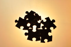 Puzzle: wrong connection (amber). Wrong puzzle like wrong connection or contact or stress or competition symbol Stock Image