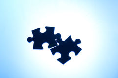 Puzzle: wrong connection (stress). Wrong puzzle like symbol of wrong connection or contact or stress or competition Royalty Free Stock Image