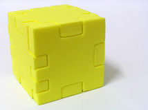 Puzzle - YELLOW. A sponge cube puzzle with white colour background Royalty Free Stock Image