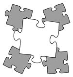 Puzzled. Blank jigsaw puzzle piece among other puzzleling pieces Royalty Free Stock Image