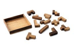 Puzzled. A wooden jigsaw puzzle ready to be solved Stock Photography