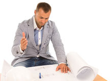 Puzzled architect looking at a building plan Stock Photography