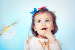 Puzzled baby girl Royalty Free Stock Photo