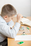 Puzzled boy looking at curcuit Stock Image