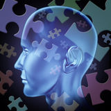 Puzzled brain. Puzzled mind and brain teasers symbol featuring a human head with jigsaw puzzle peices representing the concept of riddles of thinking and problem Royalty Free Stock Photo