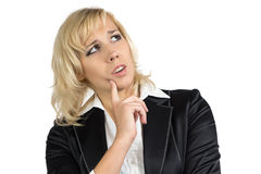 Puzzled business woman looking up Royalty Free Stock Photos